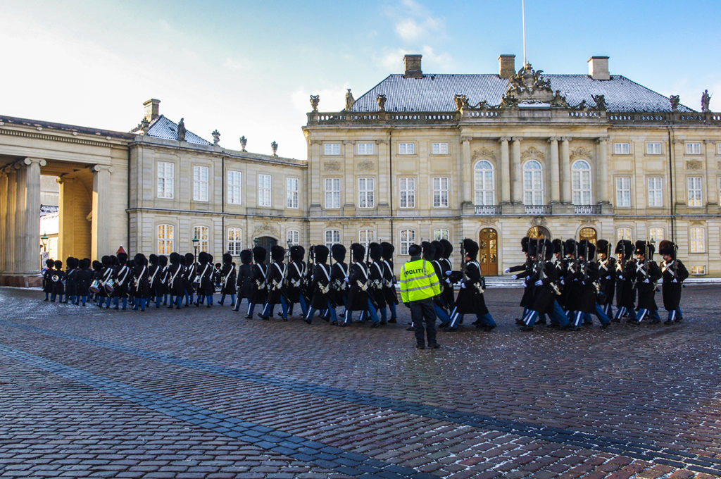 Watch the changing of the guard at Amalienborg Palace in Copenhagen.